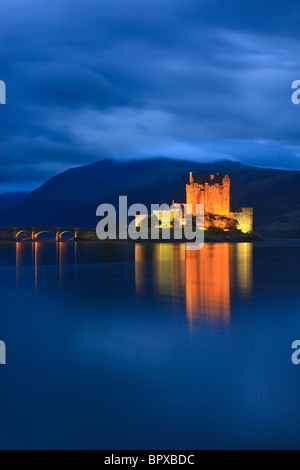 Famous Eilean Donan Castle at the blue hour after sunset, Scotland - Stock Photo