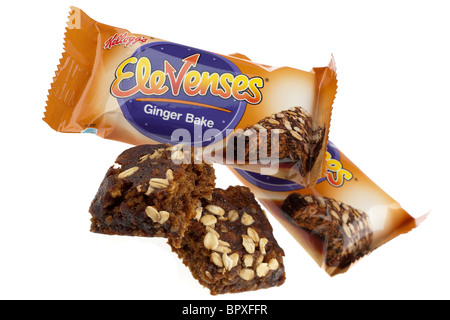 Three packets of Kelloggs elevenses ginger bake one unwrapped and broken into two pieces - Stock Photo