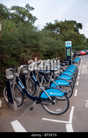 London Barclays cycle hire docking station in Hyde Park, London, England, UK, Europe, EU - Stock Photo