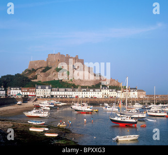 Gorey Harbour and Mont Orgueil Castle in late afternoon, Jersey, Channel Islands, United Kingdom - Stock Photo