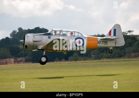 North American Aviation T-6 Texan trainer landing at Duxford - Stock Photo