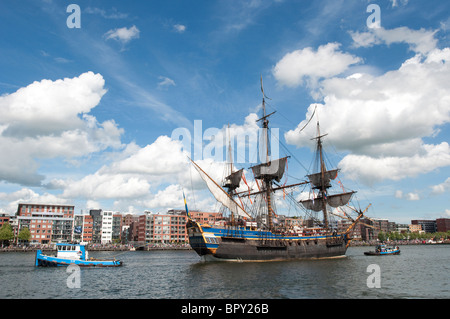 A ship enters the harbour for SAIL Amsterdam 2010. - Stock Photo
