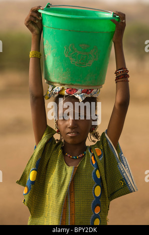 Peul girl fetching water from the senegal river, Senegal - Stock Photo