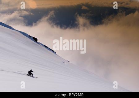A man skiing on a glacier on Mount Vsesevidov in the Aleutian Islands in Alaska. - Stock Photo