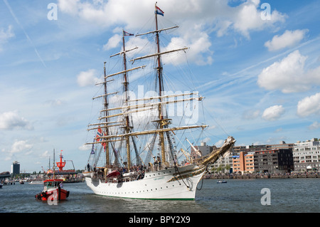 A Norwegian tall ship enters the harbour for SAIL Amsterdam 2010. - Stock Photo