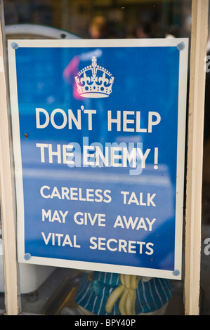DON'T HELP THE ENEMY WW2 poster in shop window for 1940s event UK - Stock Photo