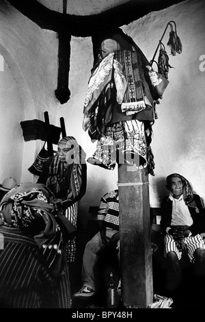The effigy of the 'dirty eating' saint Maximon crucified during the Holy Week celebrations in Santiago Atitlan, - Stock Photo