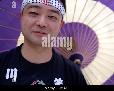 Japanese man with parasol at Akita Kanto Matsuri Lantern Festival - Stock Photo