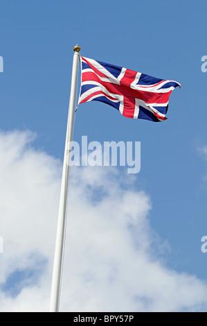 Union Jack Flag Against a Blue Sky - Stock Photo