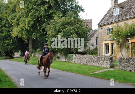 Horse riders in Evenlode village, Gloucestershire, England, UK - Stock Photo