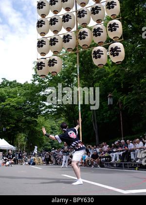 Lantern Balancing at Akita Kanto Matsuri Lantern Festival - Stock Photo
