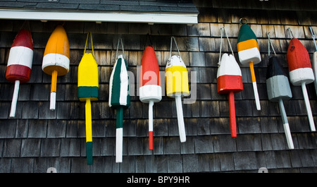 Close up row of colorful vintage buoys Lobster markerson the exterior of a fishing shack, Maine, USA, US,  United - Stock Photo
