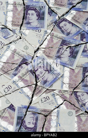 Cracked Twenty pound notes concept to represent an economic crisis - Stock Photo