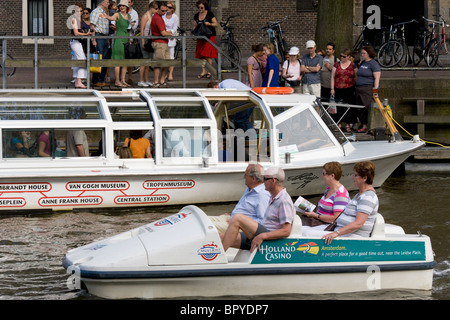 Amsterdam Prinsengracht, Princes Canal, Canal Hopper tour boat stop at Westerkerk and Anne Frank House. Canal Bike - Stock Photo