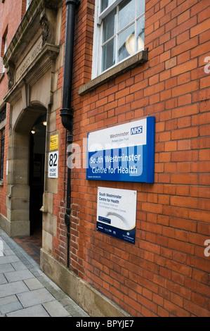 Westminster Health, hospital entrance, sign on a brick wall, Victoria, London, England, UK, Europe, EU - Stock Photo