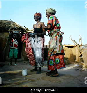Zenabu Tunnadaa is dancing with another woman from the Gambaga camp. - Stock Photo
