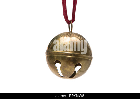 Sleigh bell Christmas ornament hanging by a red ribbon - Stock Photo
