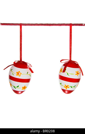 Two easter eggs hanging on a red line isolated on white - Stock Photo