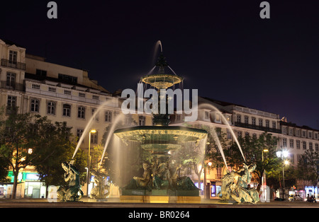 Fountain at Rossio Square in Lisbon, Portugal - Stock Photo
