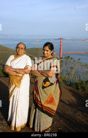 Indian tourists next to the  Golden Gate Bridge in San Francisco - Stock Photo