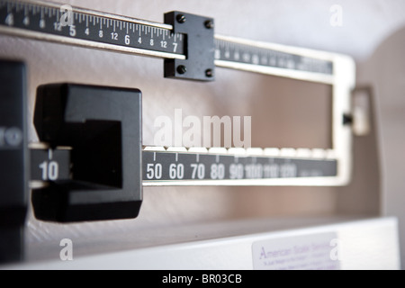 scale weigh weight adjust what you weigh pound - Stock Photo