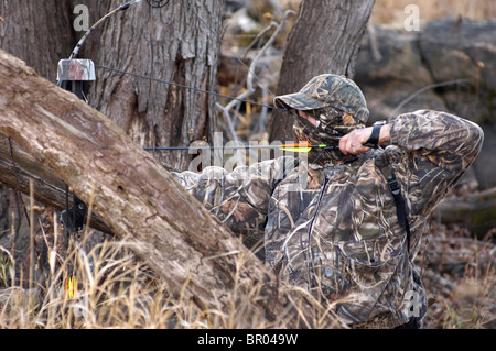 A bow hunter completely cover in Two bow hunter covered in Two bow hunter covered in A bow hunter, covered in Two - Stock Photo