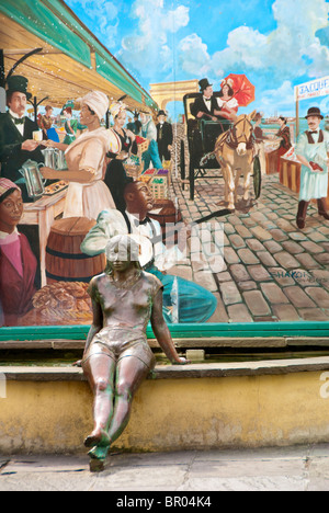 French Market fountain, statue and painting in the French Quarter of New Orleans, Louisiana, USA - Stock Photo