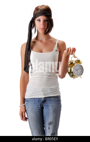 teen teenage girl on white seamless background in blue jeans and white top - Stock Photo