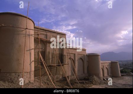 Scaffolding surrounds walls of the Queen's Palace, Babur Gardens, Kabul - Stock Photo