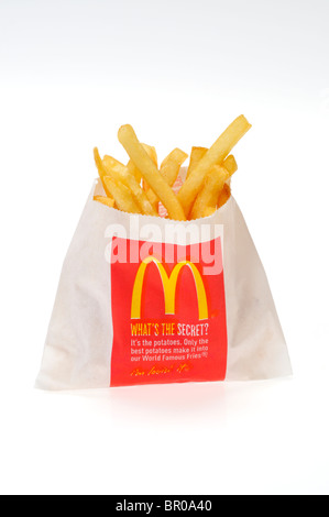 McDonald's french fries in paper packaging on white background cut out. - Stock Photo