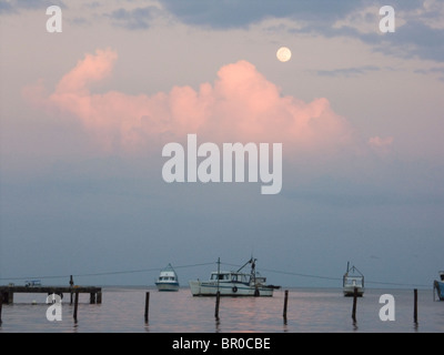 Fishing boats in the harbor on the Carribean coast of Livingston, Guatemala. - Stock Photo