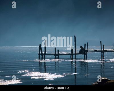 Fishermen on a pier at work on Lake Atitlan. - Stock Photo