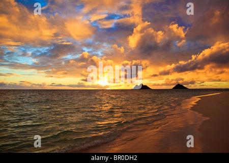 September sunrise over the Mokulua Islands at Lanikai, Hawaii - Stock Photo