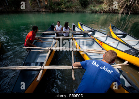Israelis canoing in Yardenit, which lies at the point the Sea of Galilee flows into the Jordan river in Israel - Stock Photo