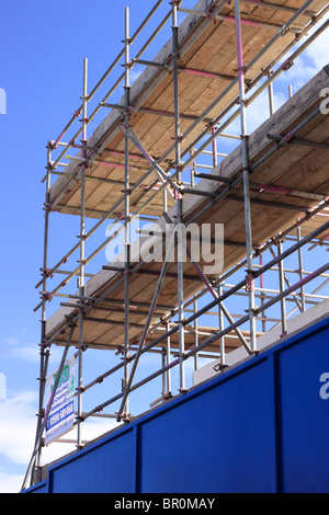 A Portrait section of the scaffolding on the building of a new Branch of Lidl supermarket. - Stock Photo