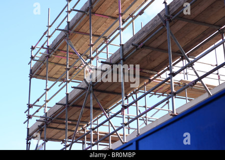 A section of the scaffolding on the building of a new Branch of Lidl supermarket. - Stock Photo