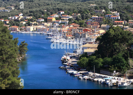 Gaios port, fishing boats and sailing boats with the greek town behind. Paxos is a small Ionian Island. - Stock Photo