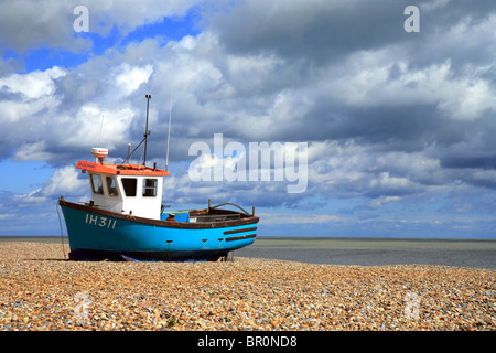 Aldeburgh beach with traditional fishing boat pulled up on the beach. - Stock Photo
