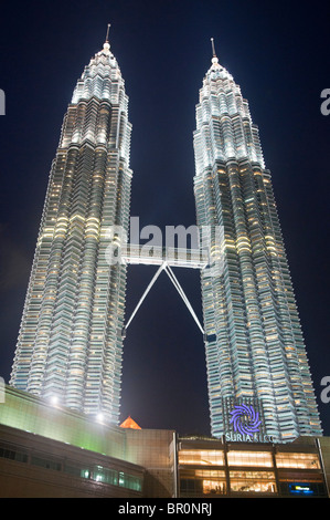 The Petronas Towers lit up at night in Kuala Lumpur, Malaysia - Stock Photo