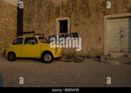 A yellow car on the islands of Iz in the Adriatic, Croatia. - Stock Photo