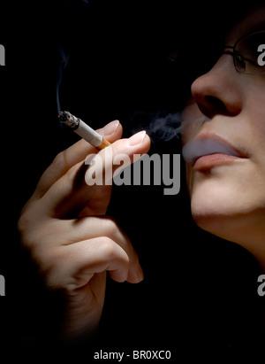 Woman smoking cigarette - Stock Photo