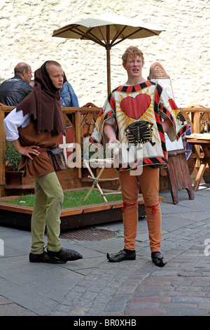 Boys dressed in medieval costume for tourists in Tallinn, Estonia - Stock Photo