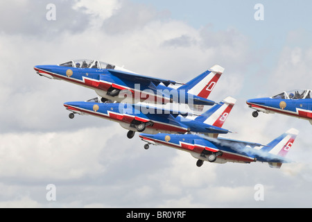 Dassault- Breguet/ Dornier Alpha jets of the French Air Forces Patrouille de France getting airborne - Stock Photo
