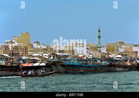 Bustling Dubai Creek and Deira area of Old Dubai UAR - Stock Photo