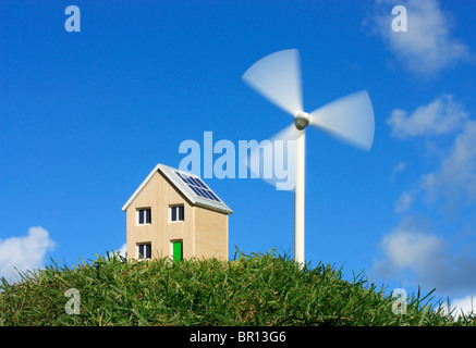 Model house and wind turbine - Stock Photo
