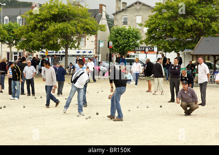 Petanque players at Perros Guirec in Brittany France - Stock Photo