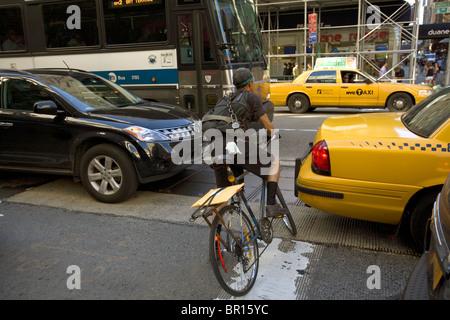 bike messenger in the city traffic stock photo 49166241. Black Bedroom Furniture Sets. Home Design Ideas