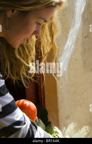 Woman selecting friut, Argentina - Stock Photo