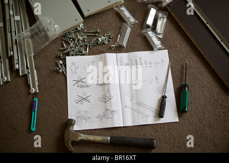 Assembling ikea furniture stock photo royalty free image for Tools to assemble ikea furniture