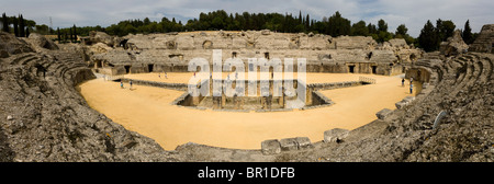 Panoramic photograph of the amphitheatre at the ruined Roman city of Italica / Itálica near Seville, Spain. - Stock Photo